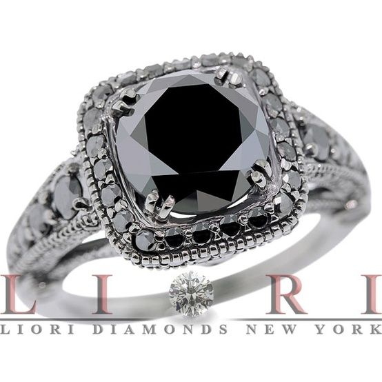 Black diamond ring.  I think the only people I know that have had black diamond engagement rings are Carmen Electra and Carrie from SATC. by...