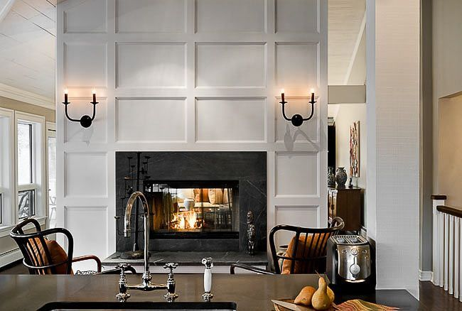 two sided fireplace so it faces both the living room and family room.