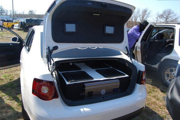 """nice set up we did in a 2010 jetta 4 12"""" kicker L5's w/ 2500w O2 amp and two tv's in the trunk lid"""