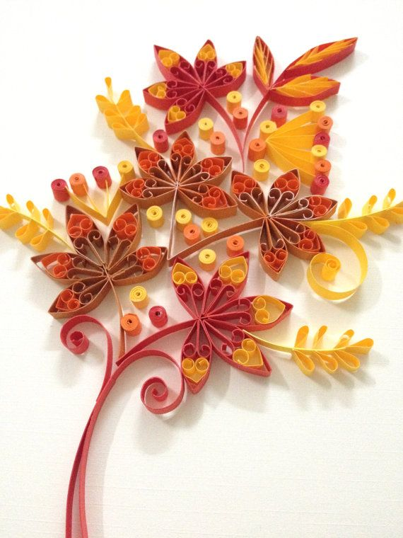 Paper quilling Autumn leaf Materials: color paper strips, glue, deep frame…
