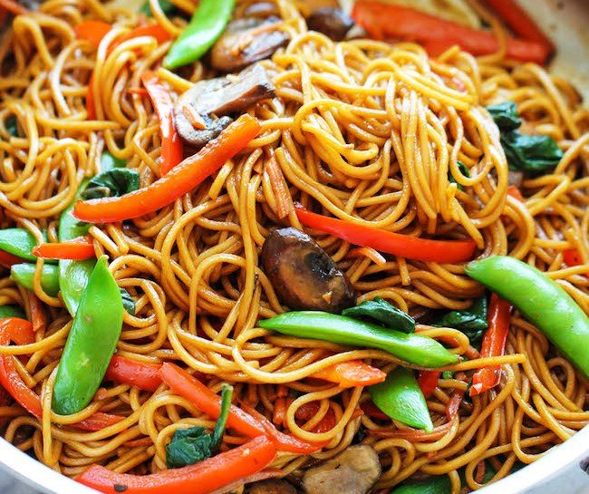 Easy Lo Mein Recipe Main Dishes with egg noodles, olive oil, garlic, cremini mushrooms, red bell pepper, carrots, snow peas, baby spinach, reduced sodium soy sauce, sugar, sesame oil, ground ginger, Sriracha