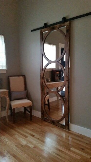 wall mirror mounted on a sliding barn track door