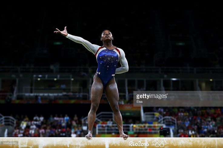 Simone Biles of the United States competes on the balance beam during the…
