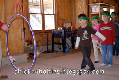 Throw stars through hula hoop game:  Start close and move farther back...