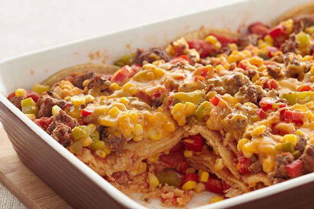 Mexican casserole. layered with ground beef, salsa, tortillas and melted cheddar cheese.