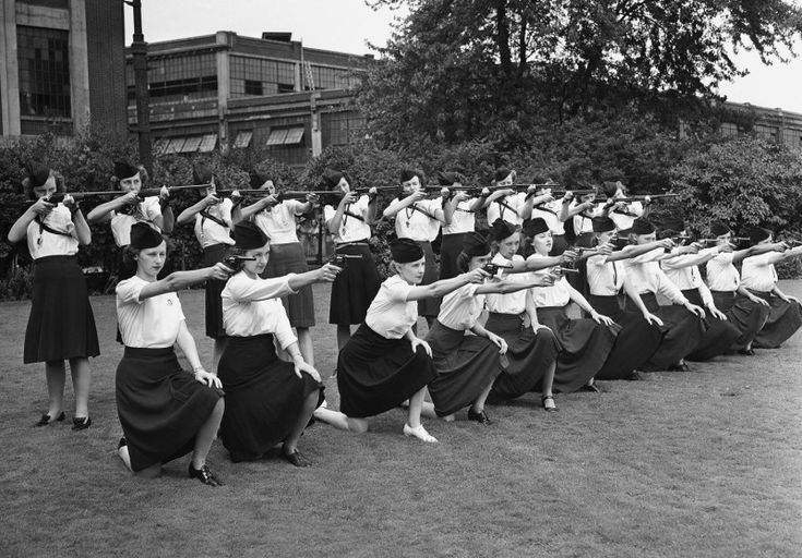 Female guards, placed on duty at the Naval Ordnance Plant, operated by the Hudson Motor Car Company in Detroit, Michigan, learn how to sight guns on August 7, 1942.