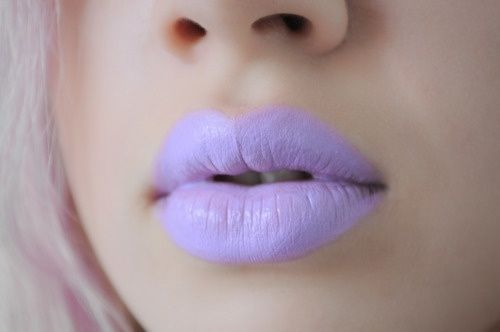 Don't like the color...but I find it funny how makeup artists put the lipstick way outside their lips...like c'mon.