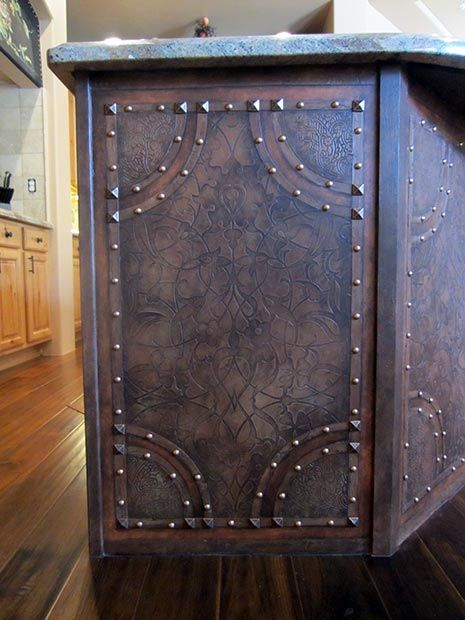 This island used to be particle board! Embossed leather technique with Royal Design Studio's Allover Arabesque Moroccan stencil and nailheads. Artist: Carmen Benoit of Arizona's Carmen Illustrates.