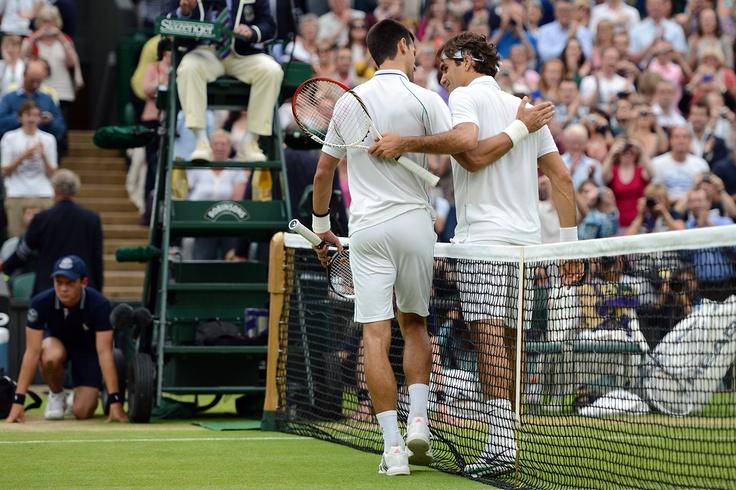 Novak Djokovic and Roger Federer congratulate eachother after their semi-final match. - Matthias Hangst/AELTC