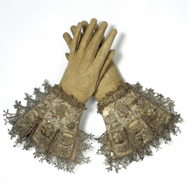 Leather, satin and embroidered and lace trimmed  early 17th century gloves From www.howretro.com:2011:11:lace-gloves