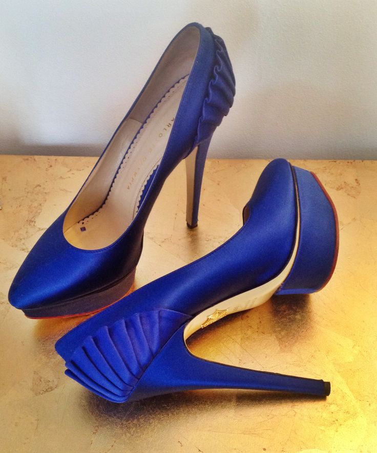 Charlotte Olympia blue satin heels.