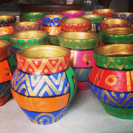 Hand painted terracotta matkis with traditional Indian designs! #Pinned by Sumit Kochar #http://www.pinterest.com/sumitkochar/