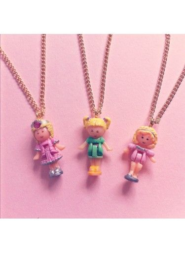 Vintage Polly Pocket necklace from Dolly bow bow. Why are these vintage? I'm so confused.