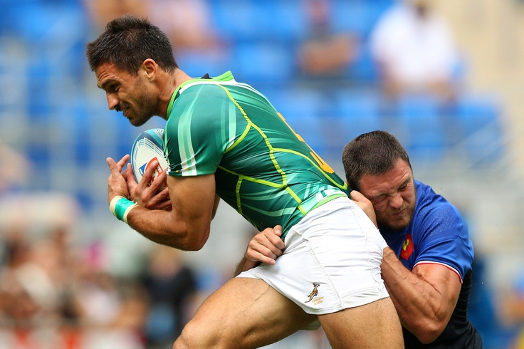Robert Ebersohn of South Africa is tackled by Vincent Deniau of France during the match between South Africa and on day two of the Gold Coast Sevens World Series at Skilled Park on November 26, 2011 in Gold Coast, Australia.