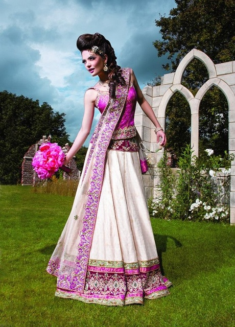 Purple and cream lehenga for wedding reception