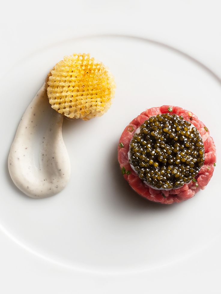 Caviar-Wagyu with wagyu beef, langoustine and Osetra caviar tartare, black pepper-vodka crème fraîche, and pomme gaufrettes by chef Eric Ripert of Le Bernardin in NYC. © Le Bernardin - See more at: http://theartofplating.com/news/caviar-wagyu-by-eric-ripert/#sthash.bnvRfTk7.dpuf