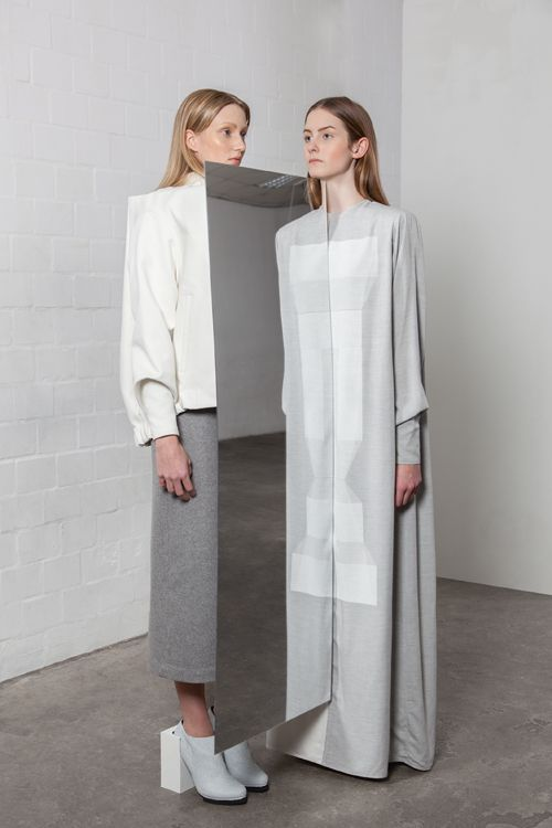 Contemporary Fashion with clean minimalist design exploring the theme of identit...