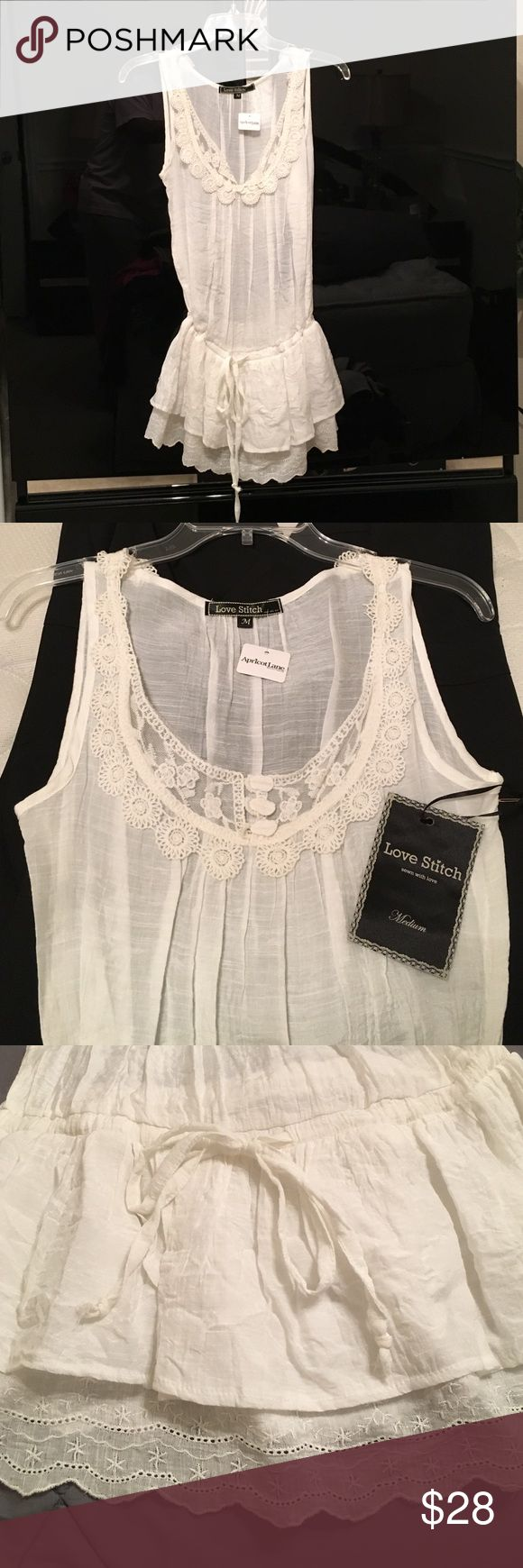 Brand new Love Stitch Blouse White with lace accents and tie waist.  Never worn with original tags from Apricot Lane. Love Stitch Tops Blouses