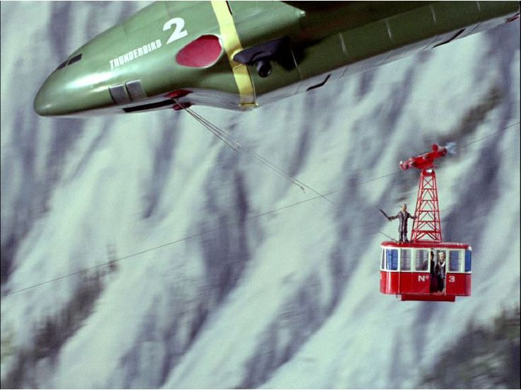 Parker and Thunderbird 2 illustrating the size and scale of TB2 - Also notice that the Pod's rollers seem to be retractable!