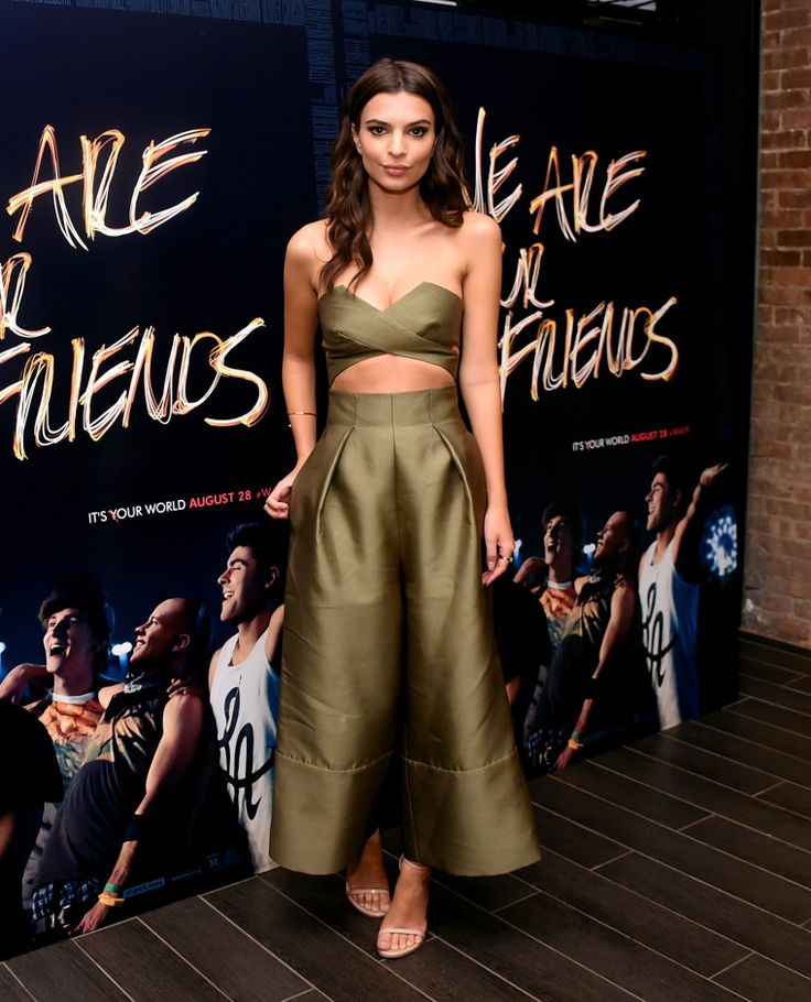 Emily Ratajkowski is unstoppable in an olive-green jumpsuit by Solace London. See all the best-dressed stars of the week on wmag.com.