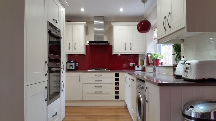 Wren Edwardian Cream kitchen with red glass splashback, ivory metro tiles, nutmeg engineered wood floor and Unsui Silestone work surfaces
