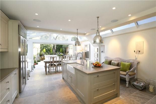 Beautiful London kitchen, moving into an all sun dining room through huge french doors to the back garden.