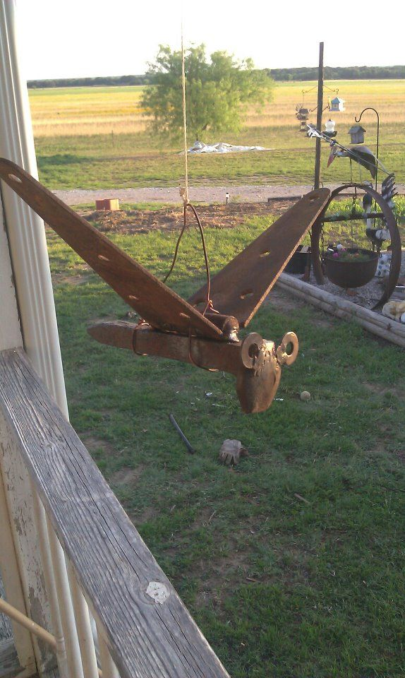 yard bird made from an old railroad spike, old hinge a a couple of washers for the eyes.