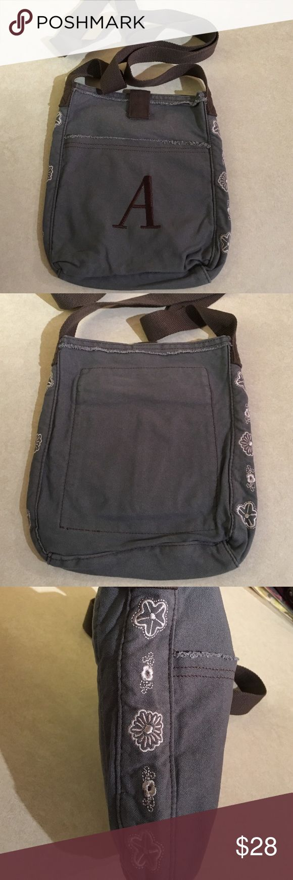 """NWOT Thirty-One Retro Metro Crossbody bag NWOT Thirty-One Retro Metro Crossbody bag in Grey with embroidered """"A"""" in brown thread. Thirty-One Bags Crossbody Bags"""