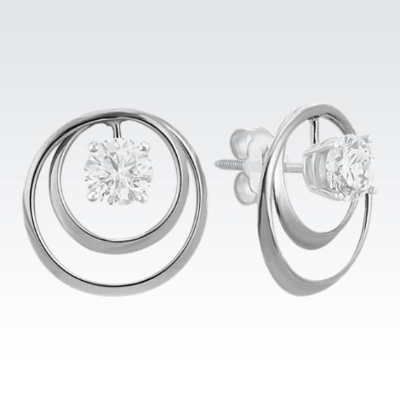 """14k White Gold Ripple Circle Earring Jackets (ShaneCo.com) (""""Freshen up your solitaire stud style with a new pair of earring jackets. This pair of circle earring jackets is crafted of quality 14 karat white gold, measure 1/2 of an inch long, and can accommodate any size of solitaire stud earrings. Simply put the post of your solitaire earring through the center of the jacket to create a fun look. The diamond solitaire earrings pictured are not included."""")"""