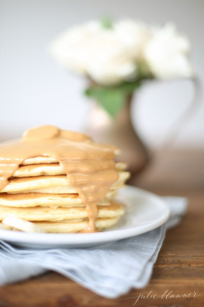 Thick, spongy classic pancake recipe with peanut butter syrup.