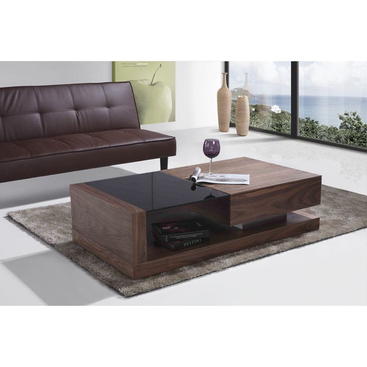 Stylish and unique, this contemporary coffee table is the perfect designer piece to take your living space to a higher level. Sleek, clean lines define the style that will impress your friends and family.