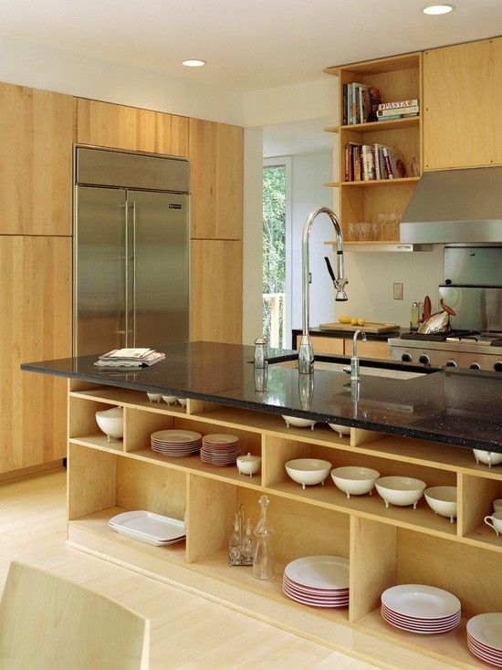 A Contemporary Kitchen With A Black Granite Top Island And A Built In Sink. Part 49