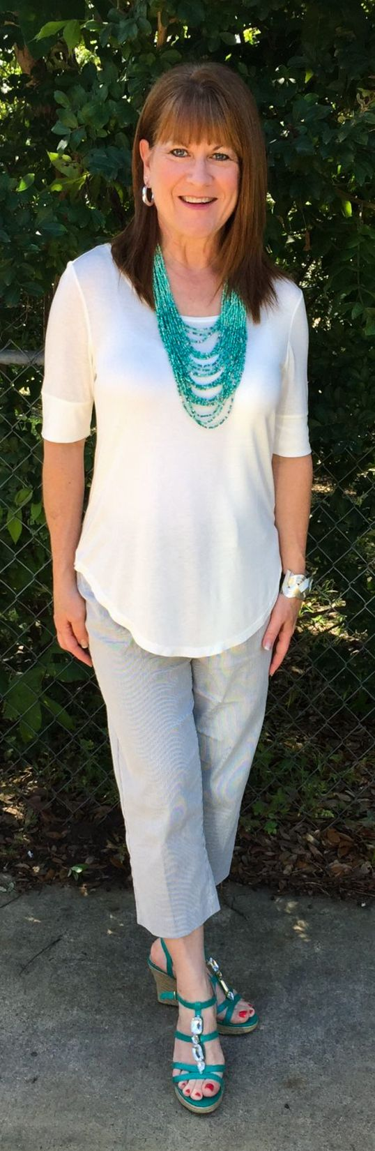I like this top and I like it with the necklace, too.  I don't have much of a waist anymore and this will be great for me.