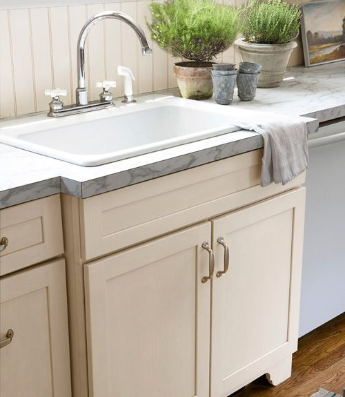 "Sink Bumping out the counter helped this enamel basin from the Home Depot look just as charming as a pricey farmhouse-style sink. Countertops At only $350 total, Guyer's laminate surfaces are ""cheap, practical, and best of all, they mimic fancy Carrara marble,"" she says. NEXT: 8 Big-Impact Ideas for a Partial Kitchen Remodel - CountryLiving.com"