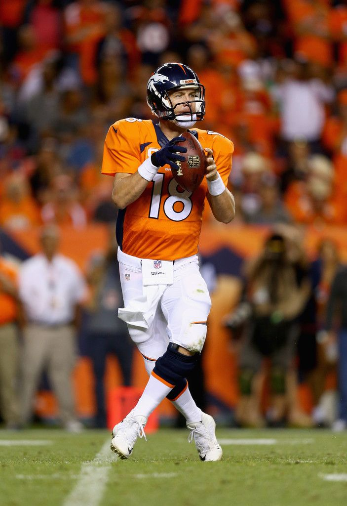 Quarterback Peyton Manning #18 of the Denver Broncos drops back to pass against the Indianapolis Colts at Sports Authority Field at Mile High on September 7, 2014 in Denver, Colorado.