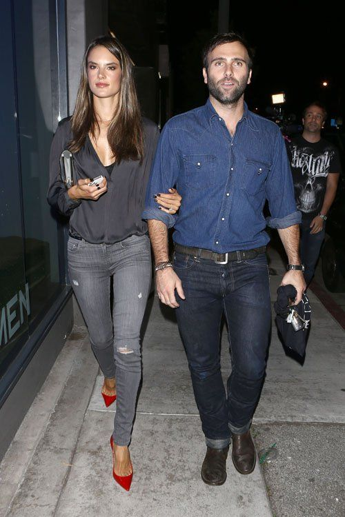 Alessandra and her husband are super casual. Except for the punch of red with her shoes.