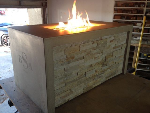 This fire table was constructed to house a propane tank with a hidden access panel for easy exchange.