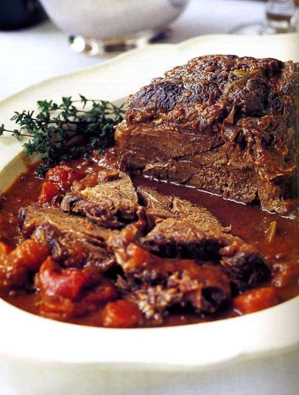 son the roast all over with 1 tablespoon salt and 1 1/2 teaspoons pepper. Dredge the roast in flour, turning to coat all sides (including th...