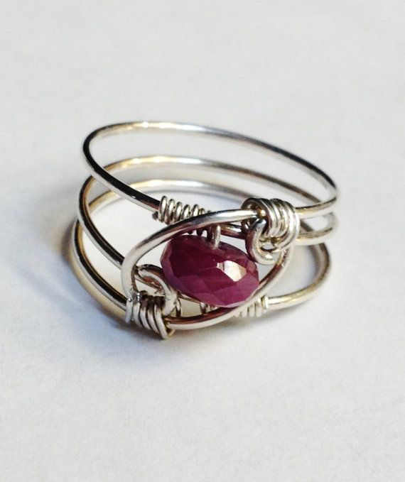 Ruby Ring Ruby gemstone ring gracefully spiraled and wrapped in sterling silver wire . This ruby gemstone is faceted with lots of gorgeous sparkle . Red Ruby Ring makes a great July Birthday gift or Christmas jewelry gift ! Ring sizes available 1-16 . Ring can be custom sized 1/2