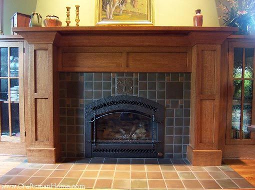 an elaborate arts and crafts fireplace surround with