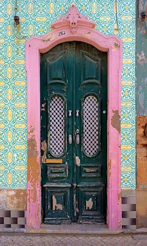 Portugal. What a colorful door concept, I love to see how things are so different world wide.