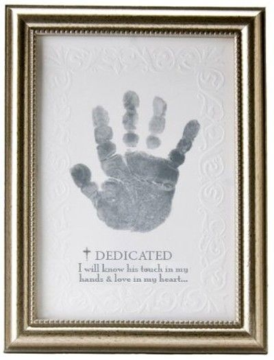 "[""This piece of wall art makes for a great way to remember your baby's dedication day. Included is child-safe silver stamp to put their handprint on the piece. At the bottom the sentiment below the title \""Dedicated\"" reads: \""I will know his touch in my hands & love in my heart...\""<br><br><b>Product Details:<\/b><br>Size: 5\""(W) x 7\""(H)<br>Wooden Frame<br>""] $18.99"