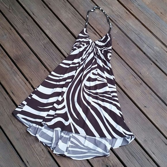 BCBG MAXAZRIA zebra print dress Backless dress cream & brown zebra-striped. Top of dress tied with fabric link and interlaced copper chain. Strip tied middle of back. Pleated chest then loose skirt. Zip closure on back.  in excellent condition. Material: 75% acetate, 21% pokyamide, 4% Lycra size S BCBGMaxAzria Dresses