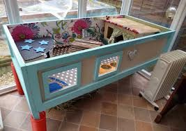 guinea pig home with bedroom house, kitchen (bowls & water), potty (potty trained area), top deck