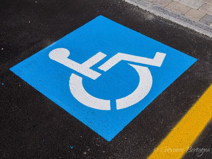 Sign disabled, detail of a signal in a parking support - Sign disabled or handicapped, detail of a signal in a parking support