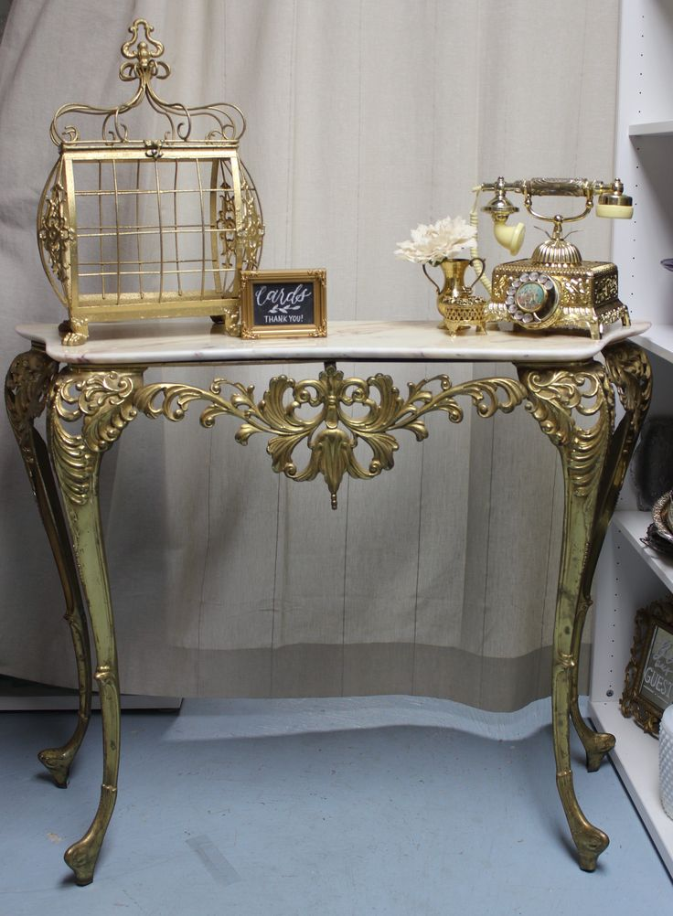 Our gold brass console table is an elegant option for creating a welcome table as shown here.  Or make it a stunning cake table, beverage station, or style your personal dressing vanity for gorgeous bridal portraits/ day of photos.