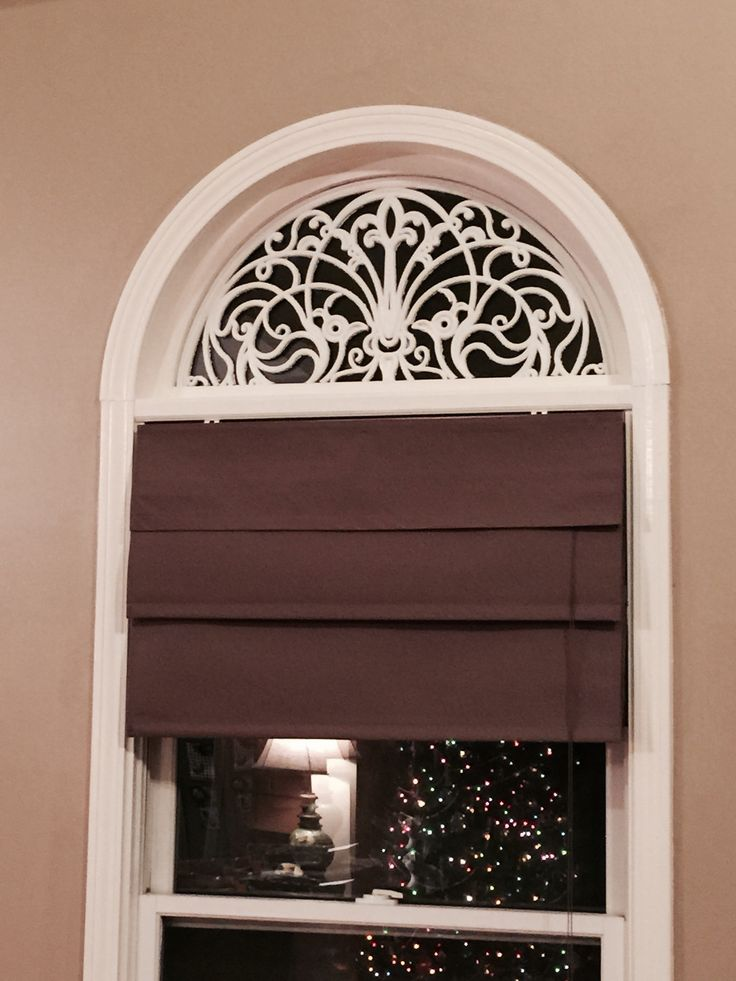 DIY faux wrought iron arch for windows using rubber door mats and spray paint.  Easy to make!