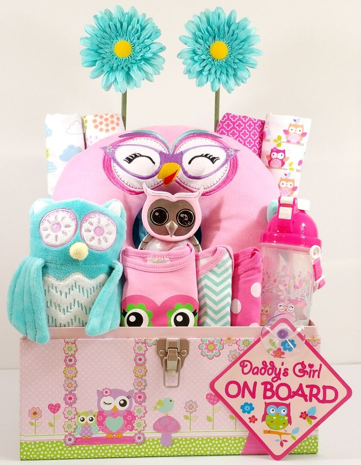 This Owl Eyes basket is a wise idea for a baby girl shower gift. The adorable trunk is filled with a plush owl, travel neck pillow, water bottle, bodysuits, receiving blankets and more all with an owl