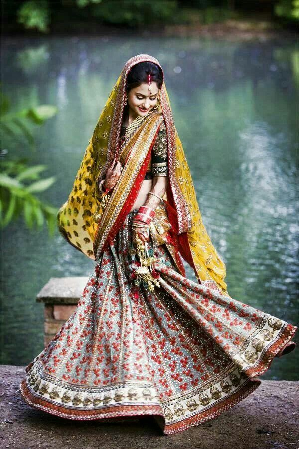 http://www.youtube.com/watch?v=AaSHAg_YHfk Sabyasachi bride - lehenga with yellow green and red