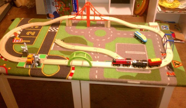 Materials: 2 Lack side tables, 1 activity rugDescription: My husband and I took two Lack tables, one activity rug and a wooden train set. We connected the two t